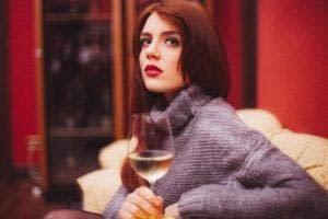 Girl with wine in a social setting